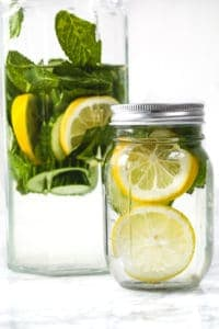 cucumber, lemon and mint detox water in a glass jug and jar