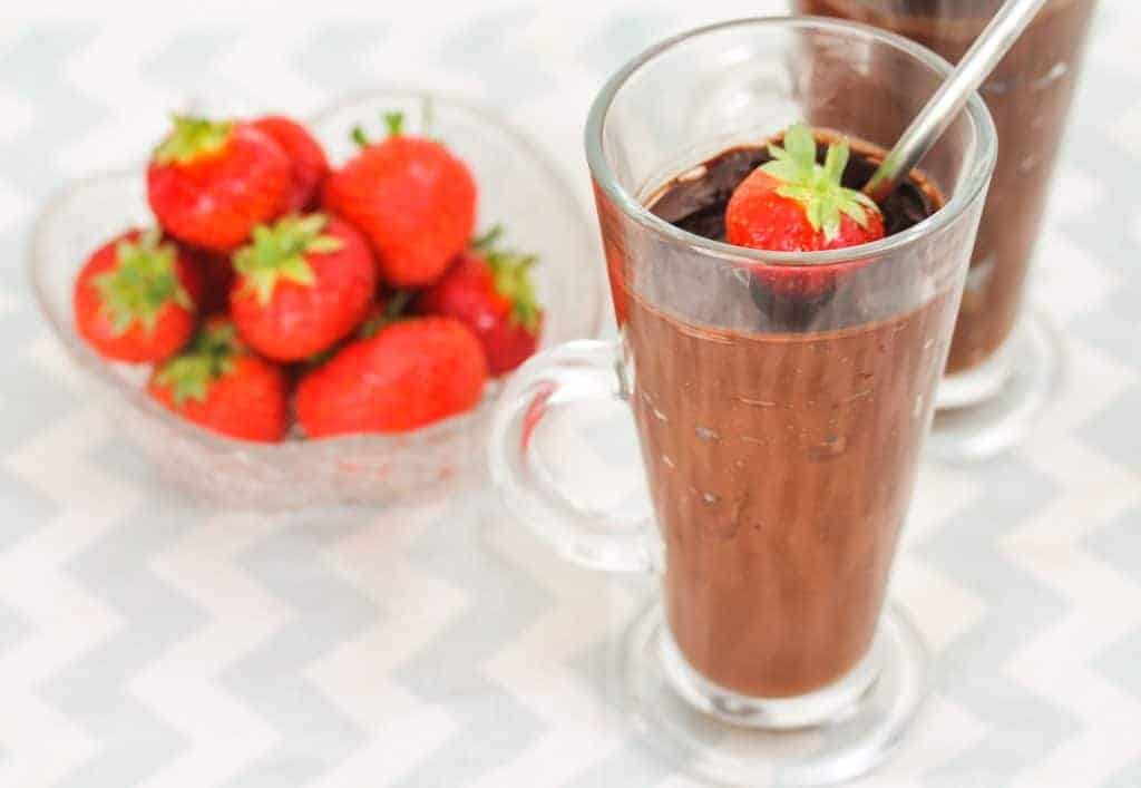 chocolate-avocado-mousse-and-strawberries for a healthy vegan dessert
