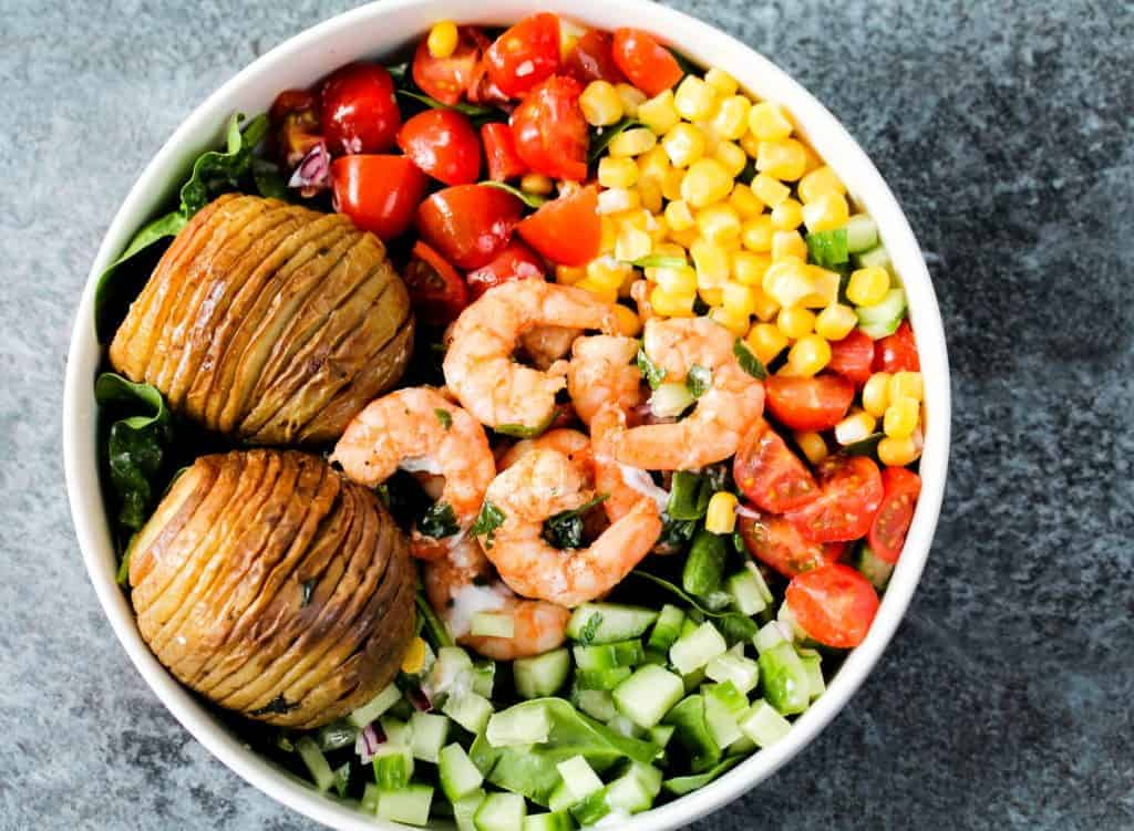 hasselback-potatoes-served-with-prawns-and-veggies a healthy lunch idea for meal prep