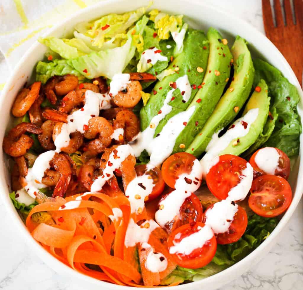 Cajun shrimp salad in a white bowl