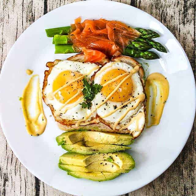A Healthy Balanced Breakfast recipe with eggs, avocado, toast, smoked salmon, and asparagus.