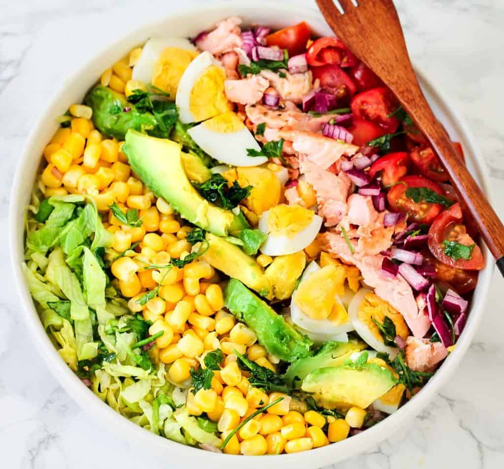 a healthy lunch idea for meal prep, salmon cobb salad bowl