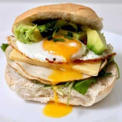 Restaurant-Style-Breakfast-Bun with egg, meat, cheese and avocado for a best healthy breakfast recipe to try.