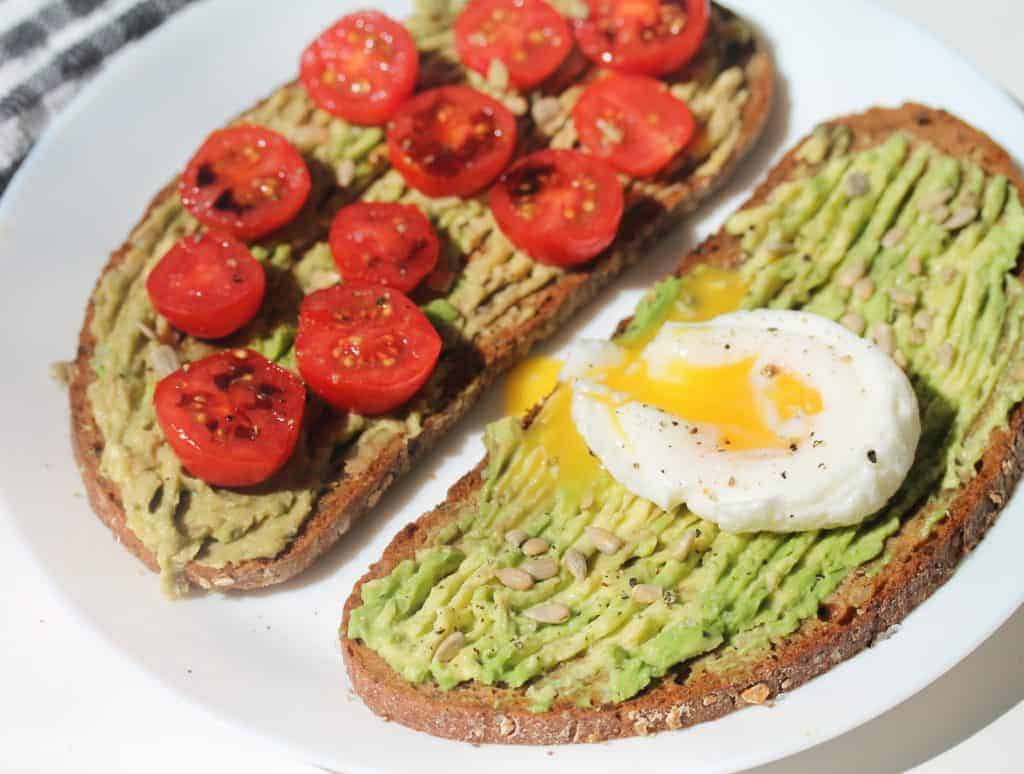 Rye Bread toast and Avocado with eggs and baby tomatoes for a healthy breakfast or brunch recipe.
