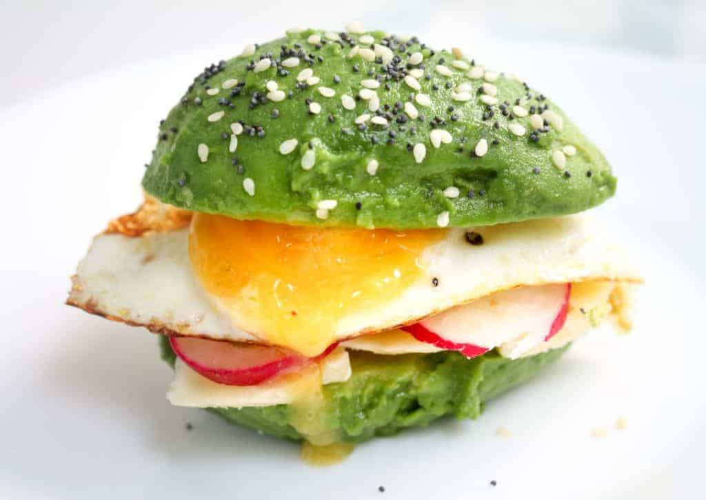 avocado-breakfast-bun with a fried egg and radishes.