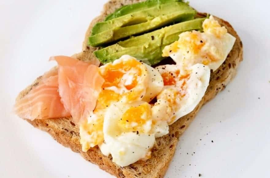 delicious-toast for breakfast with eggs, smoked salmon and avocado.