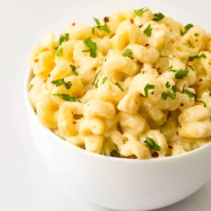 cheesy-homemade-macaroni and elbow pasta in a white ceramic bowl