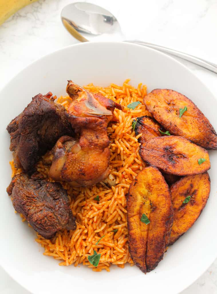nigerian jollof rice served with plantain and meat