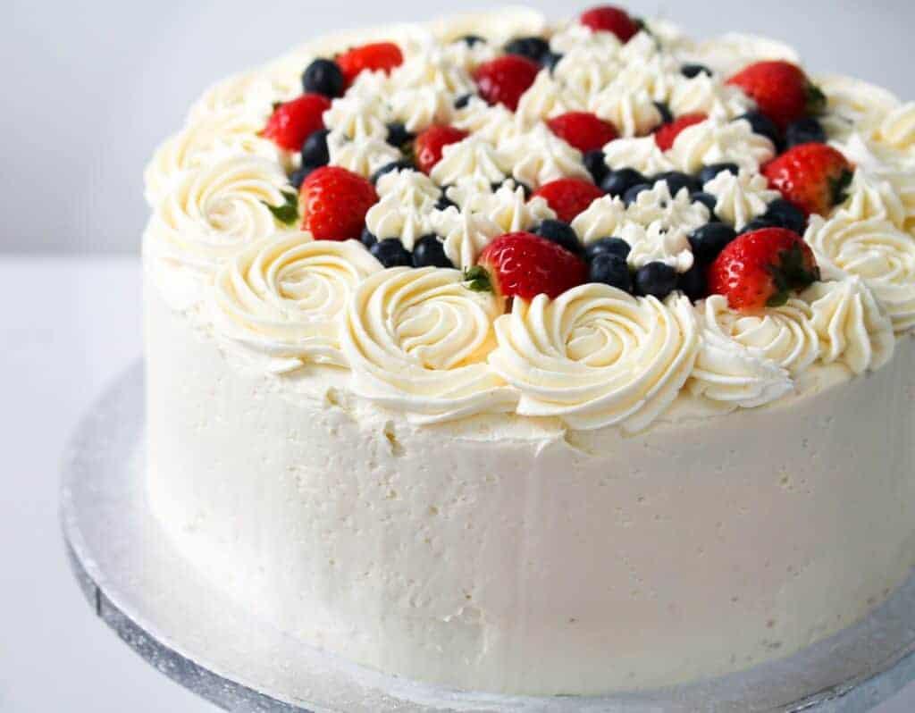 Vanilla buttercream cake decorated with fresh berries