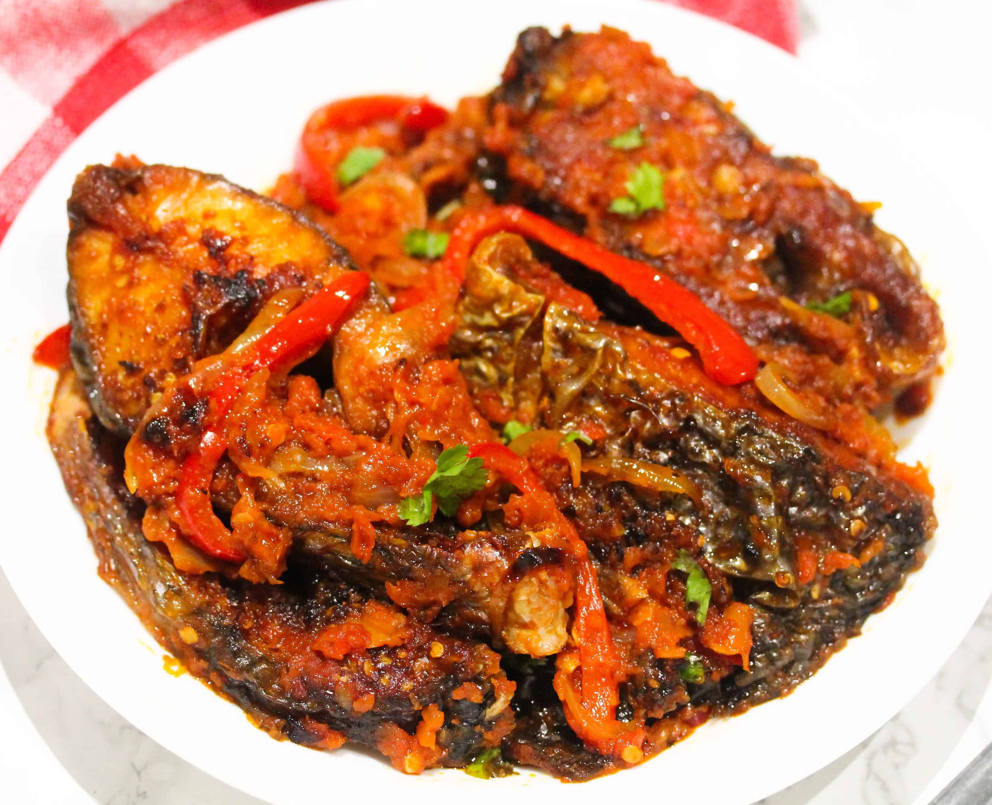 This spicy grilled tilapia recipe is filled with flavour! It includes, tomatoes, red bell peppers, onions and scotch bonnets. Serve as a side