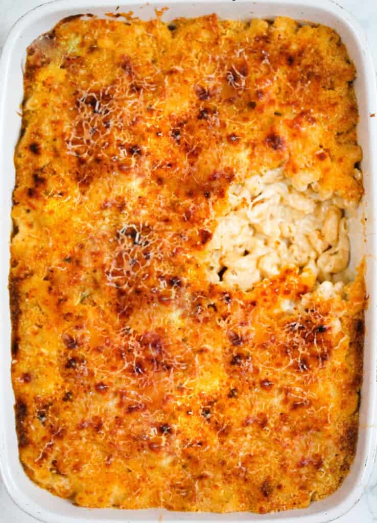 5-cheese mac n' cheese in a white oven dish with a piece missing