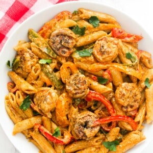 Rasta pasta with shrimp served in a plate