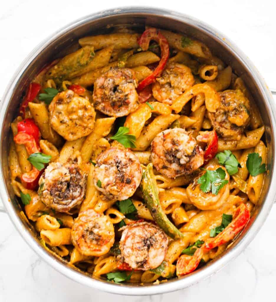 Rasta pasta with jerk shrimp in a pot