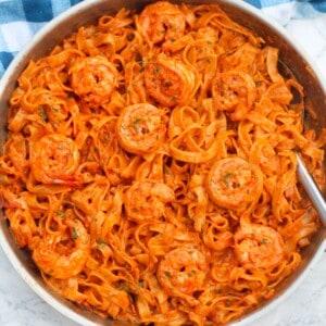 easy creamy tagliatelle tomato shrimp pasta in a pan