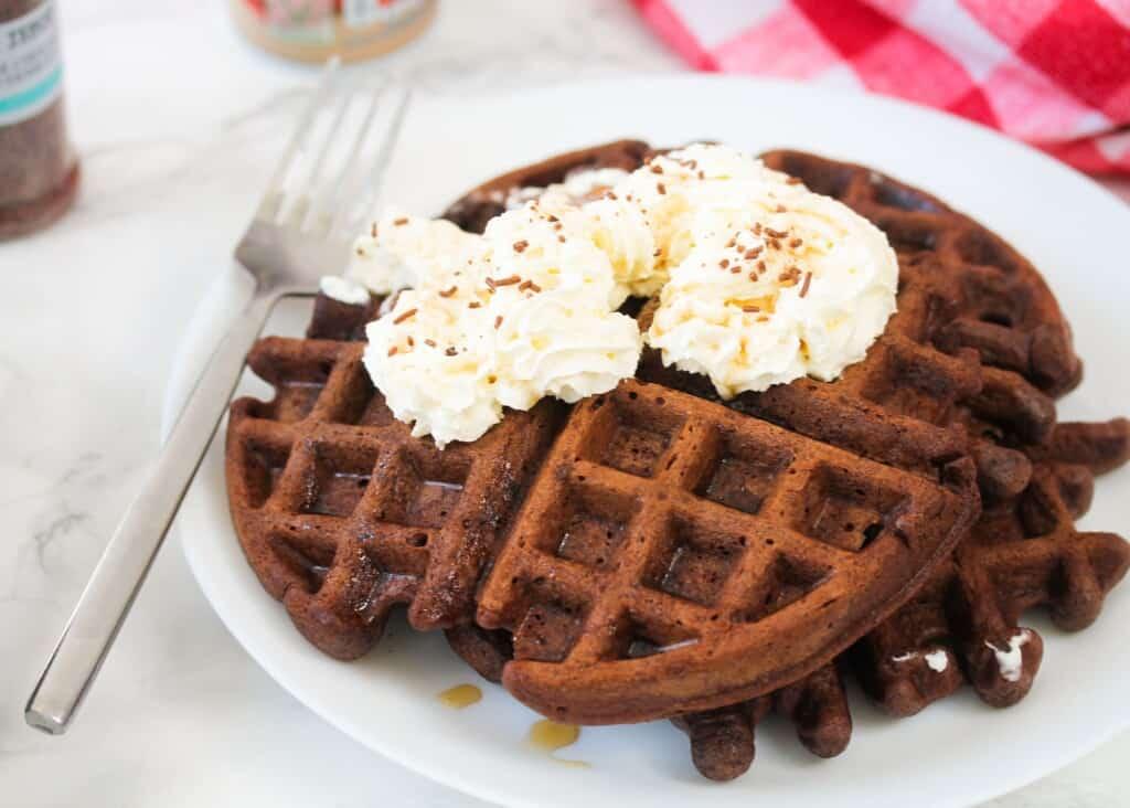 Chocolate cake waffles served on a white plate