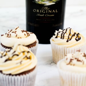 four Baileys infused cupcakes with baileys buttercream