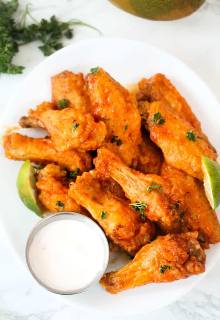 Spicy mango wings with sour cream