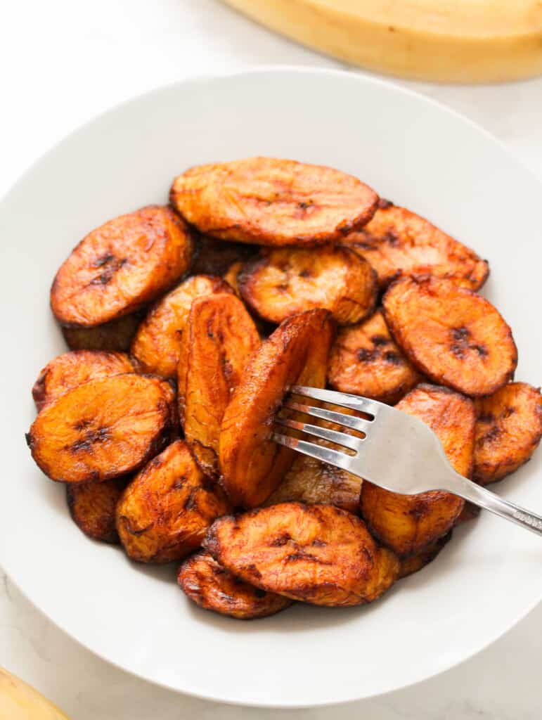 plantain in plate with fork that has been fried
